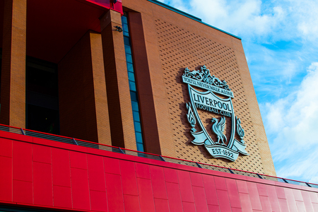 Liverpool, England, United Kingdom; 10152018: Badge or emblem of Liverpool FC in the facade of the building of Anfield Stadium Editorial