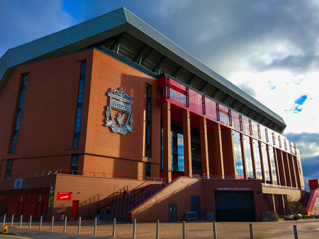 Liverpool, England, United Kingdom; 10152018: Facade of the building of Anfield Stadium with the badge of Liverpool FC and the players entrance