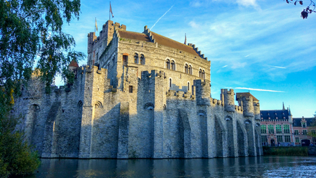 Gravensteen (or Castle of the Counts), famous medieval monument in Ghent, Belgium, with Lieve river around