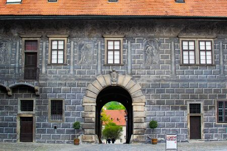 Entrance in the main wall of the State Castle of Cesky Krumlov (or Cesky Krumlov Castle), with a stone arch (Czech Republic)