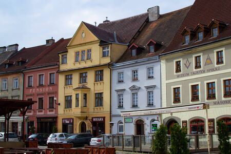 Loket, Czech Republic; 5202019: Facade of typical colorful czech houses in Loket Market, the main square, in the picturesque old town of Loket, Czech Republic