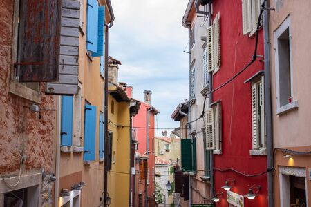Rovinj, Croatia; 7/18/2019: Picturesque narrow street with colorful facades of the houses Reklamní fotografie