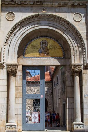 Facade of the entrance gate of the Euphrasian Basilica (also called Cathedral Basilica of the Assumption of Mary) in the old town of Porec (Parenzo), Croatia