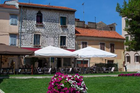 Porec (Parenzo), Croatia; 7/19/2019: Typical patio with terraces of bars in the picturesque old town of Porec