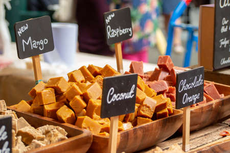 New Mango Fudge flavour and other Traditional British Fudge on sale at a confectionary stall in London's Borough Market, UK
