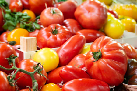Crate of Fresh Mixed Tomatoes on Sale in Borough Market, Southwark, London UK Stock Photo - 108862648