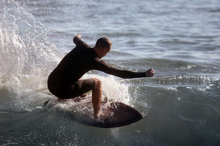 boarders: Young man surfing Stock Photo