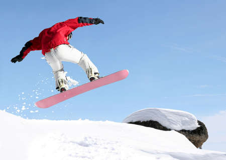 Snowboarder jumping high in the air Stock Photo - 220815