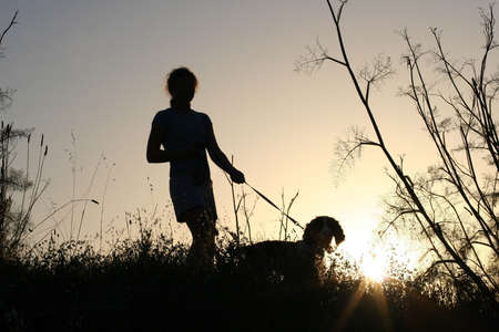 Girl and her dog at sunset Stock Photo - 220794