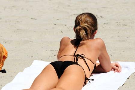 butt: A girl in bikini on the beach Stock Photo