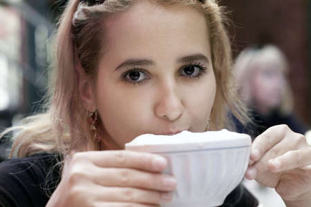 Girl drinking coffee Stock Photo
