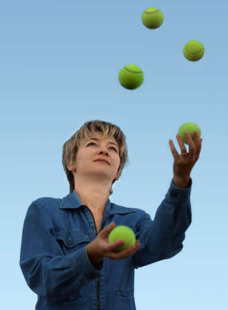 Woman juggling with tennis balls Stock Photo