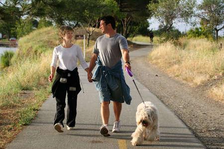Couple walking their dog photo