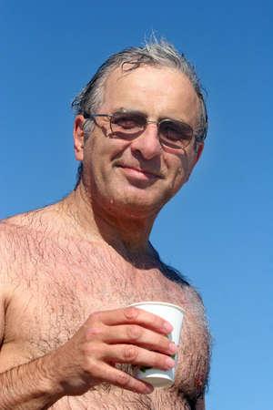 man drinking water: Mature man  at the beach
