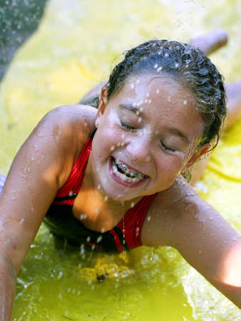 Hapyy girl on a water slide