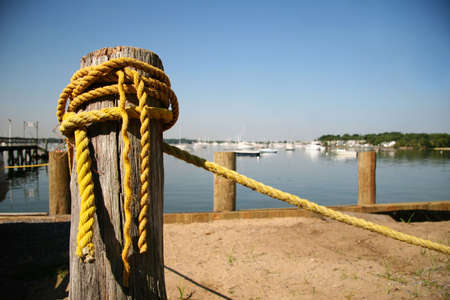 marina life: Old yellow rope at marina Stock Photo