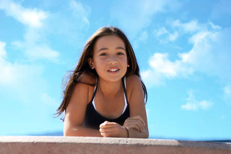 Asian teen girl against the sky