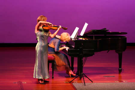 2 women playing at the concert