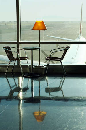 Table, lamp and 2 chairs at the airport photo