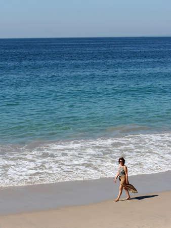 Woman walking on the beach Stock Photo - 283160