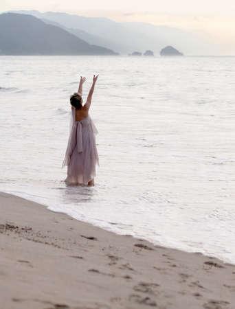 Spiritual woman on the beach