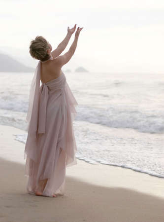 Spiritual woman on the beach photo