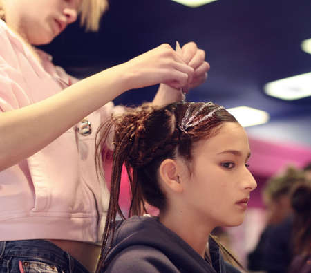 A girl getting her hair done Stock Photo