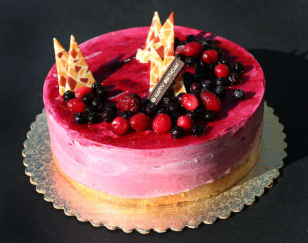 sinful: Birthday cake with berries and decorations Stock Photo