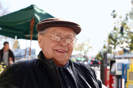 street wise: Senior man enjoying a sunny day in the city