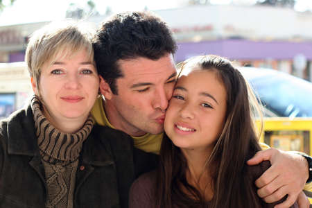 Mother, father and daughter
