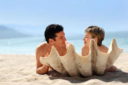 Romantic couple on the beach behind the seashell Stock Photo - 291399