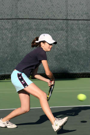 Young girl playing tennis Stock Photo - 308459
