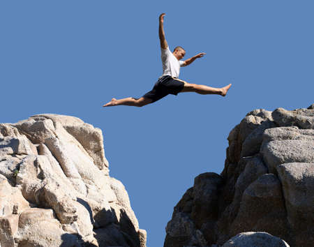 confidence: Boy jumping over the mountains