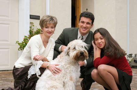 Happy family with a dog photo