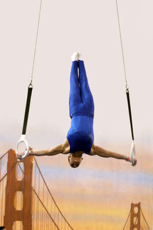 Gymnast competing on rings Stock Photo - 347549