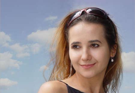 Cute girl against the sky Stock Photo - 347541