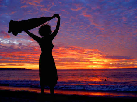 Woman on the beach at sunset Foto de archivo