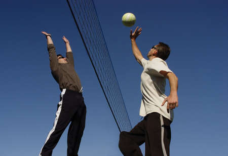 2 man playing volleyball Stock Photo - 347504