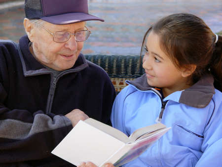 Grandfather reading a book photo