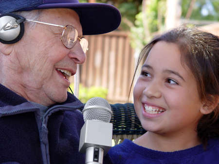Grandfather and granddaughter singing photo