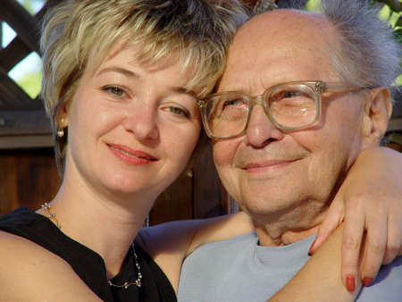Young woman and her grandfather Stock Photo