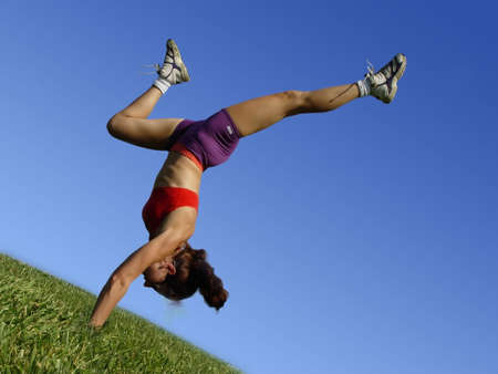 Girl exercising outdoors on the grass Stock Photo
