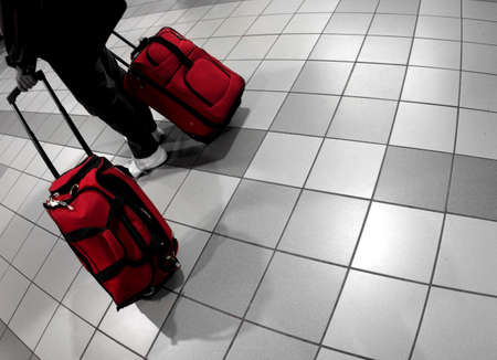 going: Man with red bags at the airport Stock Photo