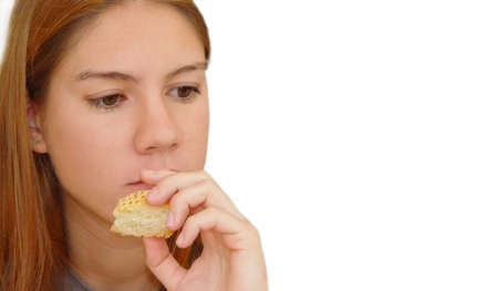 Girl with a piece of bread photo