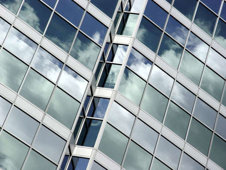 glass building: Blue sky and clouds reflected in the glass building in downtown Toronto