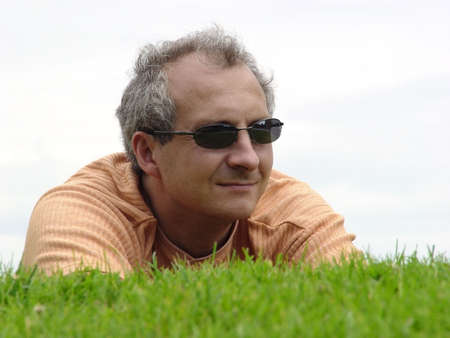 A man on the grass Stock Photo