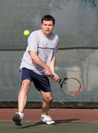 Young man playing tennis photo