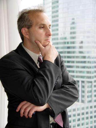 satisfy: Businessman by the window