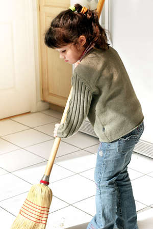 hard working woman: Little girl helping to clean the house