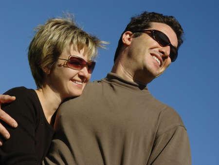 Happy couple against blue sky Stock Photo - 356010